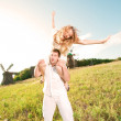 Young couple walking through summer lawn — Stock Photo #4709196
