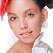 Beautiful girl with a red flower and in white gloves on a white background — Stock Photo