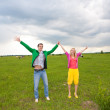 Happy smiling couple in the field — Stock Photo #4709260