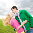 Happy smiling couple in field — Stock Photo