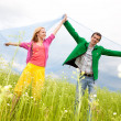 Happy Young love Couple - jumping under blue sky — Stock Photo #4709292