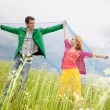 Stockfoto: Young love Couple smiling under blue sky