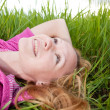 Pretty smiling girl relaxing outdoor — Stock Photo