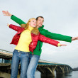 Happy smiling couple fly in sky — Stock Photo