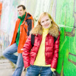 Stock Photo: Young couple backdrop of graphite wall