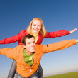 Happy smiling couple fly in sky — Stock Photo #4709456