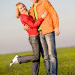 Stock Photo: Young couple playing around in the nature