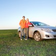 Happy young couple with new car — Stock Photo