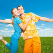 Young love Couple smiling under blue sky — ストック写真