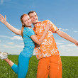 Young love Couple smiling under blue sky — 图库照片