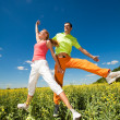 Happy is jumping in field — Foto Stock