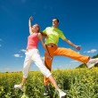 Happy is jumping in field — Stockfoto