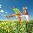 Royalty-Free Stock Photo: Happy is jumping in field