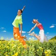 Happy is jumping in field — Stock Photo #4709626