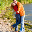Young love Couple embrace on coast of river — Stock Photo #4709671