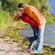 Young love Couple kissed on coast of river. — Stock fotografie #4709672