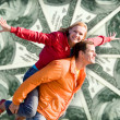 Stock Photo: Portrait Young love Couple smiling under money, 100 american dol