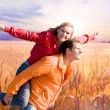 Portrait Young love Couple smiling under Golden wheat ready for — Stock Photo