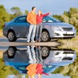 Happy young couple with their new car. Woman show something by h — Stock Photo #4709712
