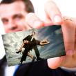A studio shot of a businessman holding out a blank business card — Stock Photo