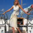 Young woman on sailboat — Foto Stock