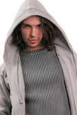 Portrait of young man dressed in modern clothes with a hood — Stock Photo