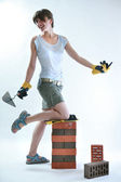 Young female painter holding trowel — Stock Photo