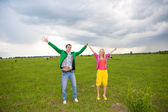 Happy smiling couple in the field — Stock Photo