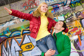 Happy smiling love couple fly backdrop of graphite wall — Stock Photo