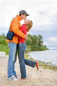 Young love Couple kissed on on coast of river. — Stock Photo