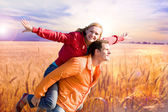 Portrait Young love Couple smiling under Golden wheat ready for — 图库照片