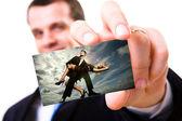 Um tiro de estúdio de um empresário segurando um cartão em branco — Fotografia Stock
