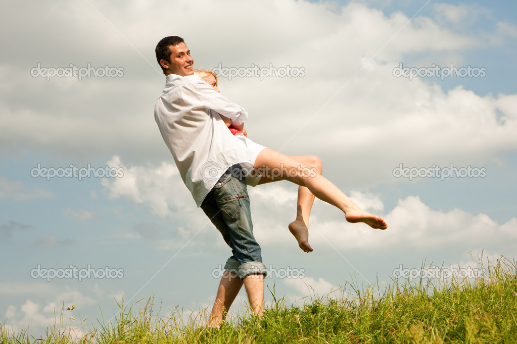 Happy young couple  jumping in sky above a green meadow — Stock Photo #4708423