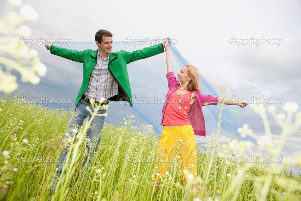 Young love Couple smiling under blue sky — Stock Photo #4709293