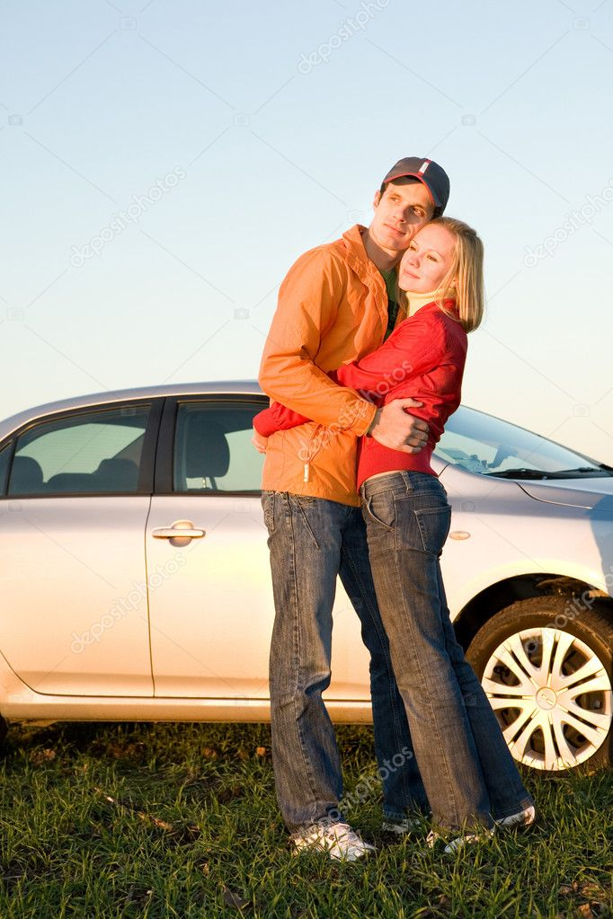Happy young couple with their new car — Stock Photo #4709566