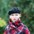 Beautiful blonde outdoors in coat and hat — Stock Photo #4710058