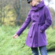 Beautiful blonde outdoors in coat and hat - 