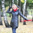 Beautiful blonde outdoors in coat and hat — Stock Photo #4710072