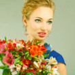 Foto Stock: Portrait Beautiful girl with flower. Focus on eyes