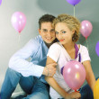 Young love Couple smiling with balloons — Stock Photo