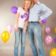Stock Photo: Young love Couple smiling with balloons