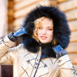 Portrait smiling young woman with a fur hood. Photography for fa — Stock Photo #4710434