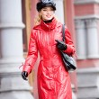 Smiling girls in red coats and hat — Stock Photo
