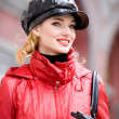 Portrait of smiling girls in red coats and hat — Stock Photo #4710439