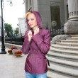 Beautiful Young Woman in clothes. Against backdrop of building — Stok fotoğraf #4710479