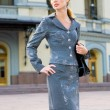 Beautiful Young Woman in suit against the backdrop of the theatr — Стоковое фото #4710495