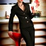 Beautiful woman drinking pink wine at bar — Stock Photo