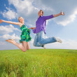 Happy is jumping in field — Stock Photo