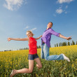 Happy is jumping in field — Stock Photo #4710700