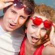 Young love Couple stares took off his glasses under blue sky - Stockfoto